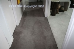 carpet pooling in hallway