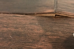 Engineered wood end peaking and delamination